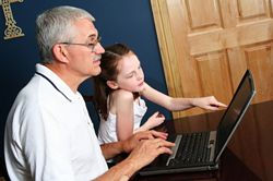 child learning with her Grandpa
