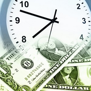 Clock and banknotes - Time is money concept