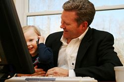 father and young son at computer