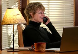 Female baby boomer works on cell phone