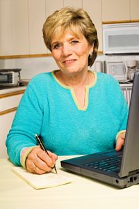 mature woman working at home in kitchen