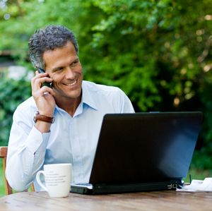 happy mature man working outdoors