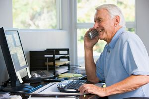 senior working in home office