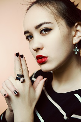 Women in the polished nail, ear-rings, and clean hair